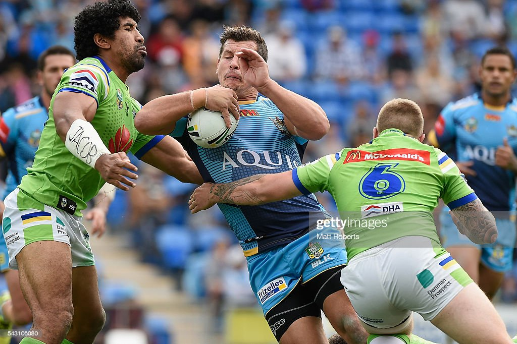 <a gi-track='captionPersonalityLinkClicked' href=/galleries/search?phrase=Greg+Bird+-+Rugby+Player&family=editorial&specificpeople=14983686 ng-click='$event.stopPropagation()'>Greg Bird</a> of the Titans is tackled during the round 16 NRL match between the Gold Coast Titans and the Canberra Raiders at Cbus Super Stadium on June 26, 2016 in Gold Coast, Australia.
