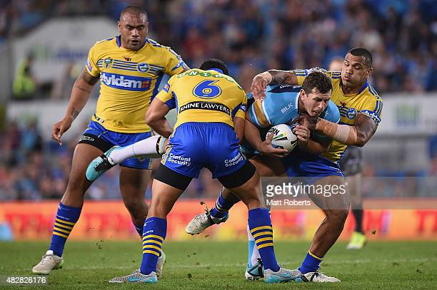 Greg Bird of the Titans is tackled during the round 21 NRL match between the Gold Coast Titans and the Parramatta Eels at Cbus Super Stadium on...