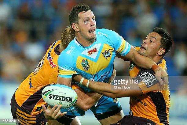 Greg Bird of the Titans is tackled during the round five NRL match between the Gold Coast Titans and the Brisbane Broncos at Cbus Super Stadium on...
