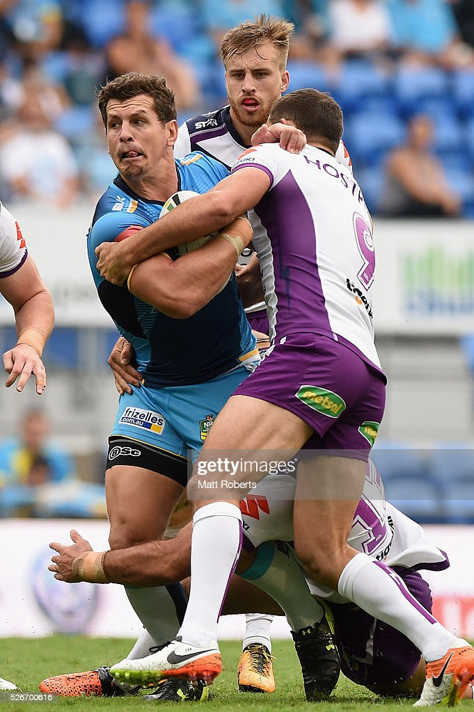 Greg Bird of the Titans is tackled during the round nine NRL match between the Gold Coast Titans and the Melbourne Storm on May 1, 2016 in Gold Coast, Australia.