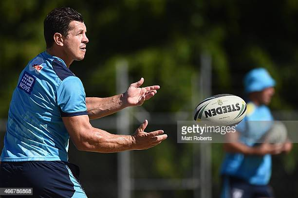 Greg Bird passes the ball during a Gold Coast Titans training session at Cbus Super Stadium on March 19 2015 on the Gold Coast Australia
