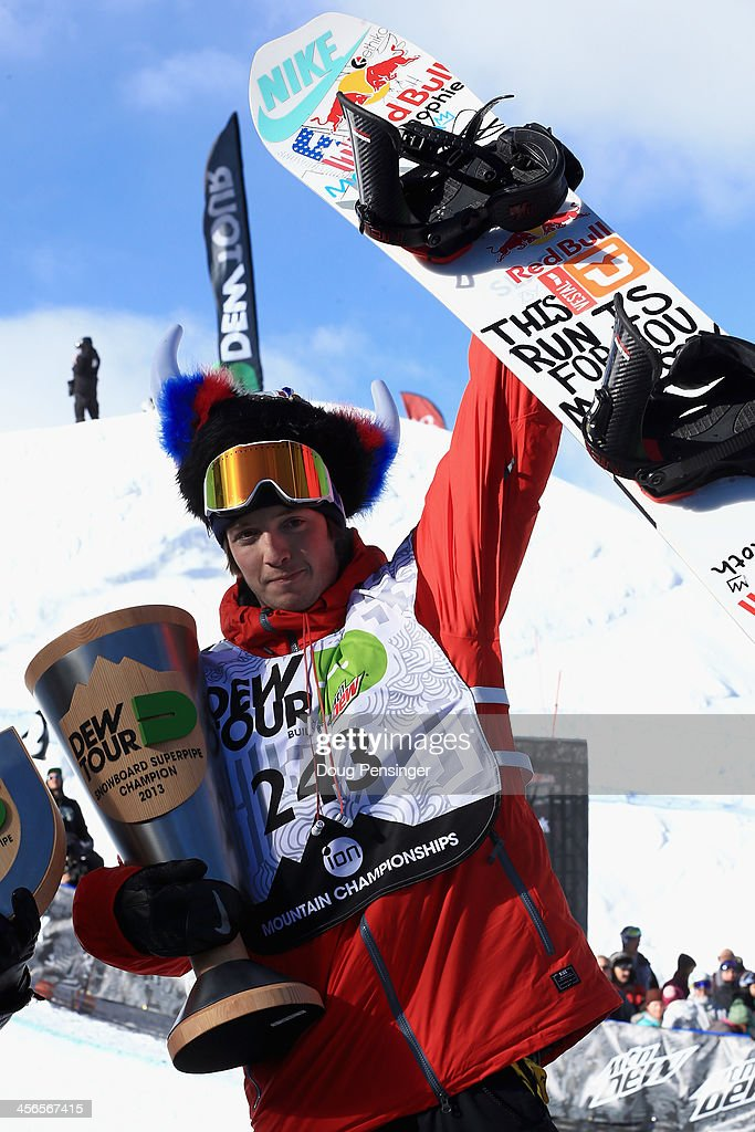 Greg Bretz celebrates on the podium after winning the men's snowboard superpipe final at the Dew Tour iON Mountain Championships on December 14, 2013 in Breckenridge, Colorado.
