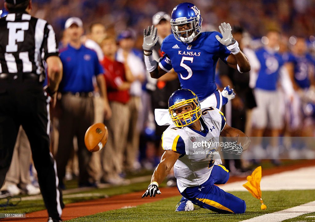 Greg Brown #5 of the Kansas Jayhawks is called for pass inteference on Tyrel Kool #2 of the South Dakota State Jackrabbits during the game at Memorial Stadium on September 1, 2012 in Lawrence, Kansas.