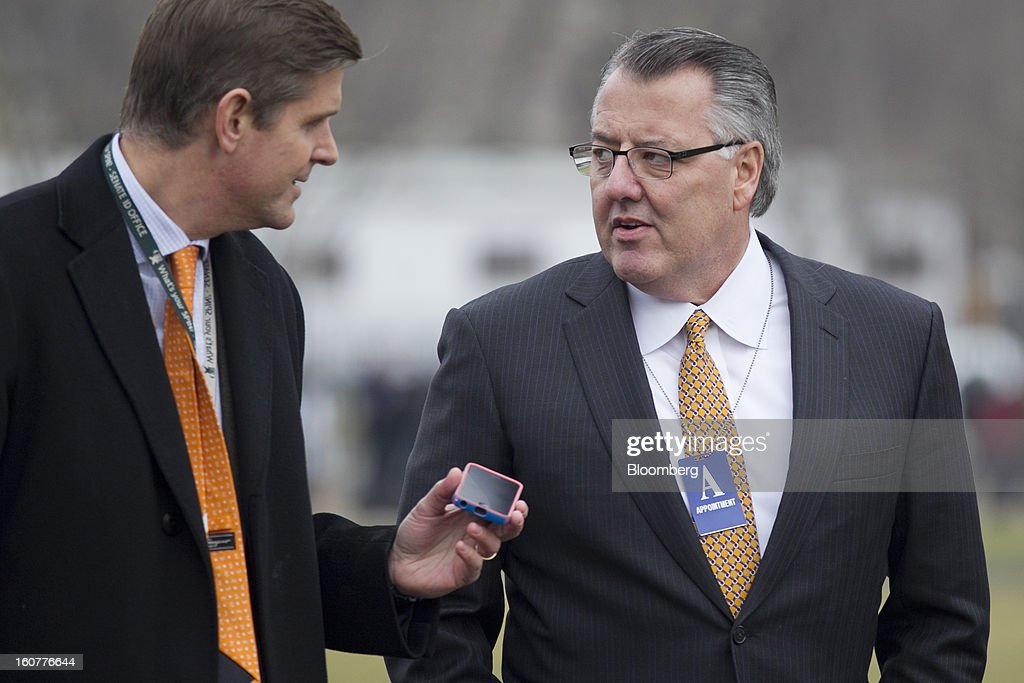 Greg Brown, president and chief executive officer of Motorola Solutions Inc., right, speaks to a reporter as he arrives to the White House to meet with U.S. President Barack Obama in Washington, D.C., U.S., on Tuesday, Feb. 5, 2013. U.S. Obama urged Congress to postpone automatic spending cuts scheduled to begin March 1 to avoid 'real and lasting impacts' on U.S. economic growth. Photographer: Andrew Harrer/Bloomberg via Getty Images