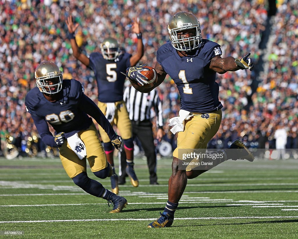 Greg Bryant #1 of the Notre Dame Fighting Irish runs for a touchdown in front of C.J. Prosise #20 as Evertt Golson #5 signals the score against the North Carolina Tar Heels at Notre Dame Stadium on October 11, 2014 in South Bend, Indiana.