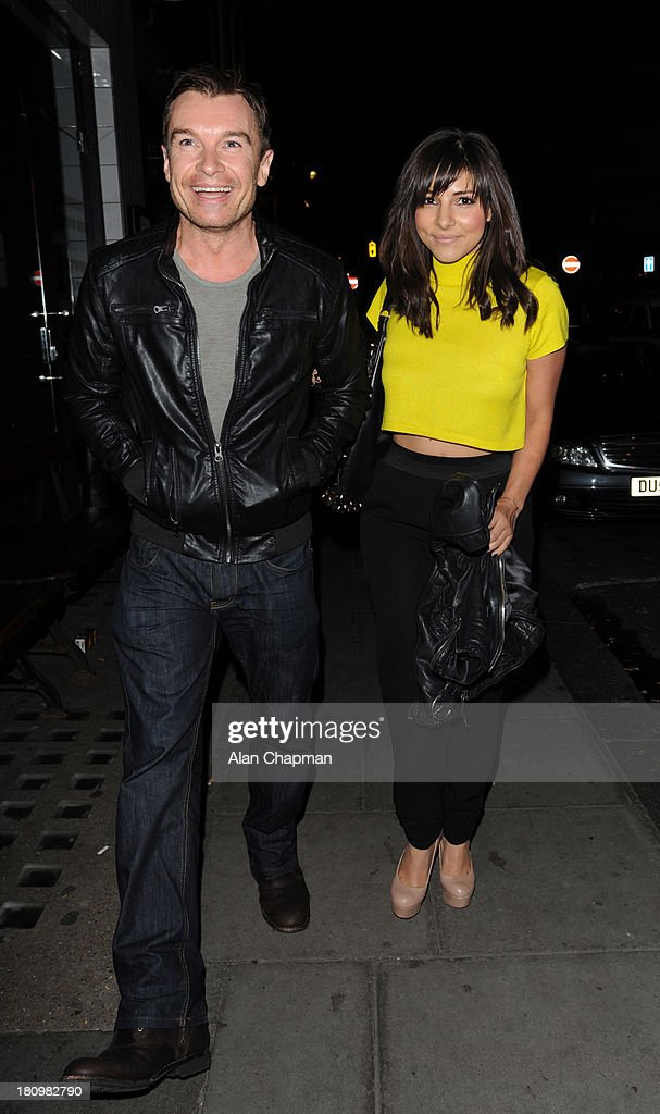 Greg Burns and Roxanne Pallet sighting leaving The Groucho Club on September 18, 2013 in London, England.