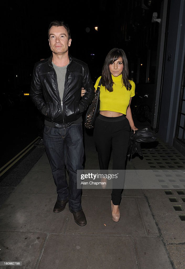 Greg Burns and Roxanne Pallet sighting leaving The Groucho Club on September 18 2013 in London England