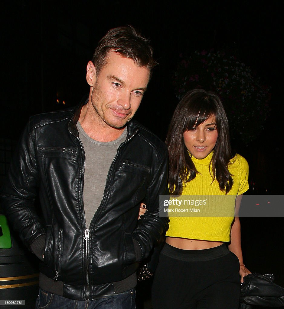 Greg Burns and <a gi-track='captionPersonalityLinkClicked' href=/galleries/search?phrase=Roxanne+Pallett&family=editorial&specificpeople=626727 ng-click='$event.stopPropagation()'>Roxanne Pallett</a> leaving the Groucho club on September 18, 2013 in London, England.