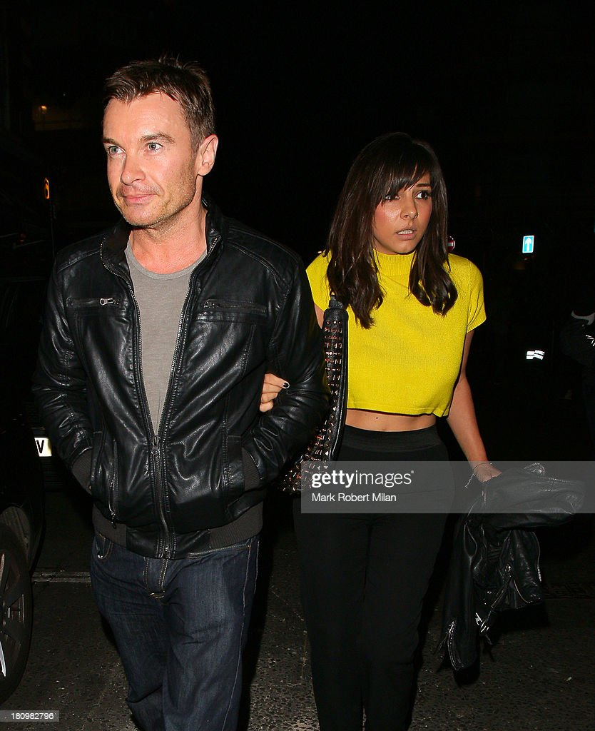 Greg Burns and Roxanne Pallett leaving the Groucho club on September 18, 2013 in London, England.