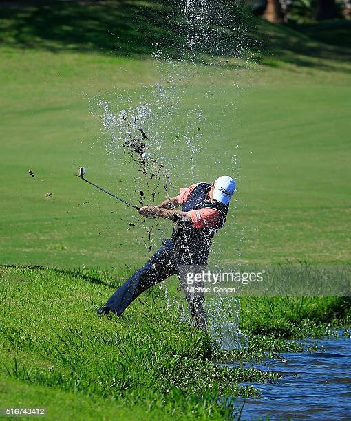 Greg Chalmers of Australia hits his fourth shot on the 12th hole from a water hazard during the final round of the Chitimacha Louisiana Open...