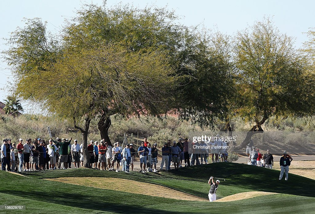 <a gi-track='captionPersonalityLinkClicked' href=/galleries/search?phrase=Greg+Chalmers&family=editorial&specificpeople=822049 ng-click='$event.stopPropagation()'>Greg Chalmers</a> of Australia plays his second shot on the 14th hole during the final round of the Waste Management Phoenix Open at TPC Scottsdale on February 5, 2012 in Scottsdale, Arizona.