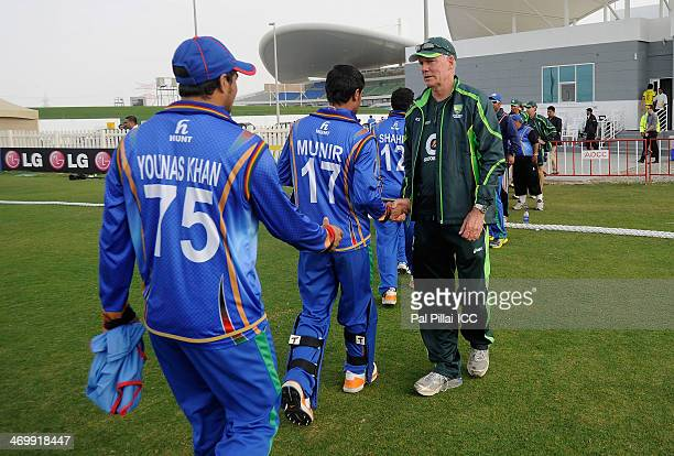 Greg Chappell manager of team Australia and former Australian cricketer congratulates players from Afghanistan at the end of the ICC U19 world cup...