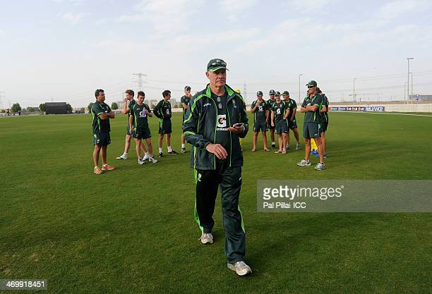 Greg Chappell manager of team Australia and former Australian cricketer walks back to the pavilion after having a word with the team at the end of...
