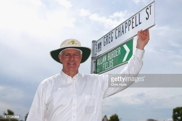 Greg Chappell poses for a photograph with the new street sign named after him at the National Cricket Centre on November 11 2013 in Brisbane Australia