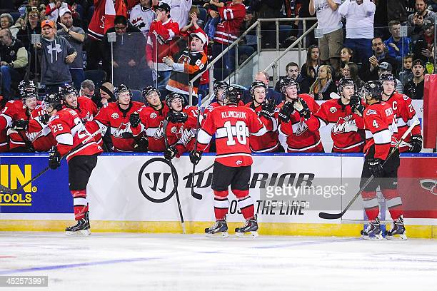 Greg Chase Morgan Klimchuk and Madison Bowey of the WHL AllStars celebrate with the bench after a goal against team Russia during Game Six of the...