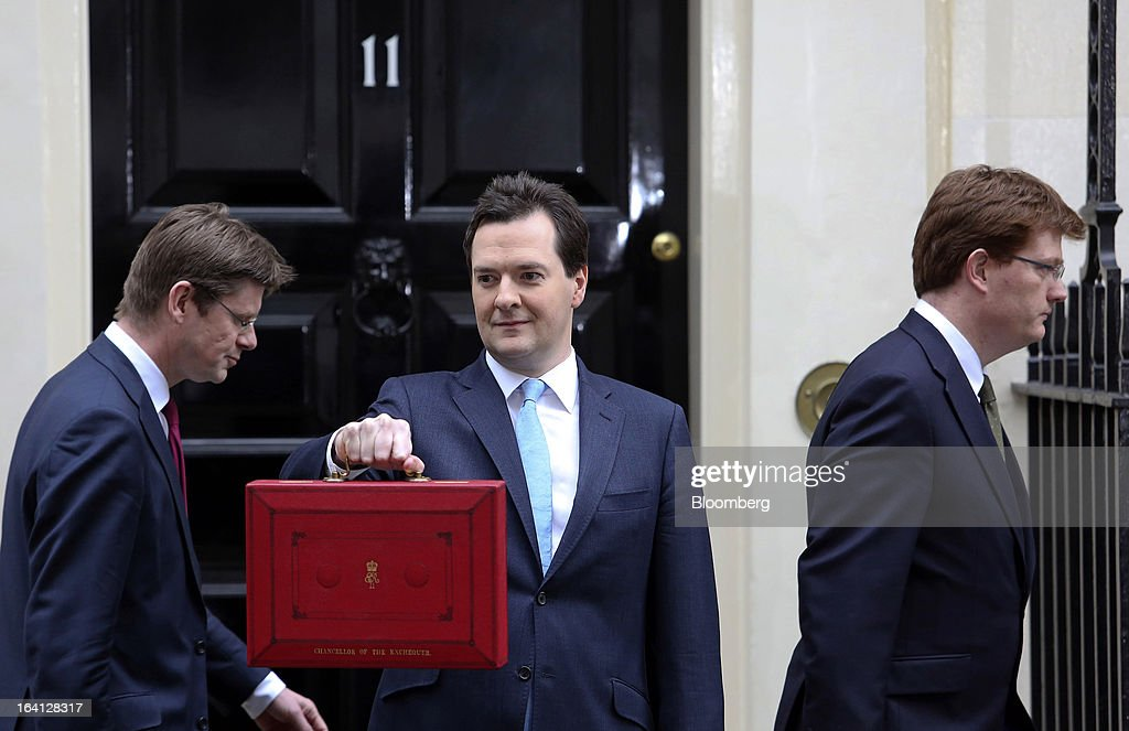 Greg Clarke, U.K. financial secretary to the treasury, left, and Danny Alexander, U.K. chief secretary to the treasury, right, with <a gi-track='captionPersonalityLinkClicked' href=/galleries/search?phrase=George+Osborne&family=editorial&specificpeople=5544226 ng-click='$event.stopPropagation()'>George Osborne</a>, U.K. chancellor of the exchequer, as he holds the dispatch box containing the 2013 budget outside 11 Downing Street in London, U.K., on Wednesday, March 20, 2013. Osborne promised another austere budget as calls to stimulate the U.K. economy became more muted, easing political pressure on the government. Photographer: Chris Ratcliffe/Bloomberg via Getty Images