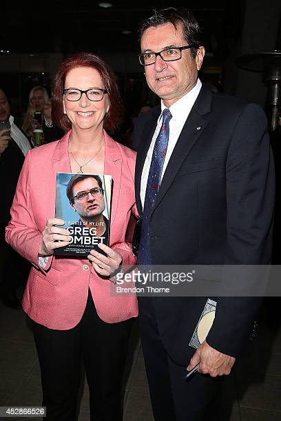 Greg Combat and former Prime Minister Julia Gillard pose at the launch of former cabinet minister Greg Combet's book 'The Fights of My Life' at...