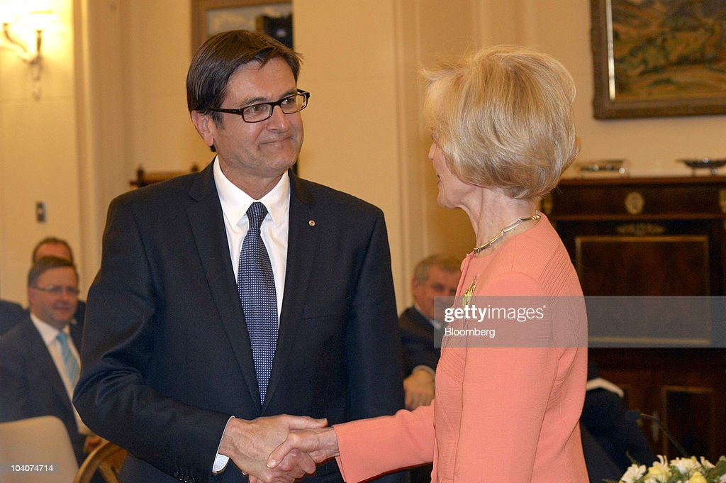 Greg Combet, Australia's minister of climate change and energy, left, is sworn in by <a gi-track='captionPersonalityLinkClicked' href=/galleries/search?phrase=Quentin+Bryce&family=editorial&specificpeople=2602196 ng-click='$event.stopPropagation()'>Quentin Bryce</a>, Australia's governor general, in Canberra, Australia, on Tuesday, Sept. 14, 2010. The Labor-led administration was sworn in today in Canberra. Photographer: Joseph Lafferty/Bloomberg via Getty Images