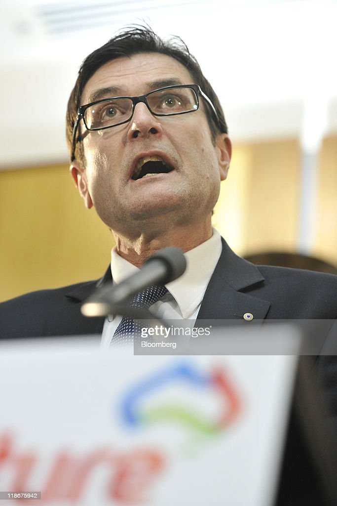 Greg Combet, Australia's minister of climate change, speaks during a news conference on the government's climate change plan at Parliament House, in Canberra, Australia, on Sunday, July 10, 2011. Gillard unveiled Australia's first tax on greenhouse gas emissions from July 2012 to reduce dependence on fossil fuels and encourage renewable energy in the world's biggest-coal exporting country. Photographer: Mark Graham/Bloomberg via Getty Images