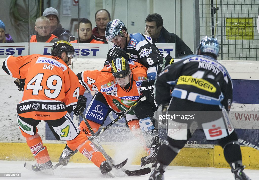 Greg Day and Olivier Latendresse of Graz challenge Andrew Hedlund and Curtis Murphy of Linz (L-R) during the Erste Bank Eishockey Liga match between Black Wings Linz and Moser Medical Graz99ers at Keine Sorgen EisArena on December 21, 2012 in Linz, Austria.