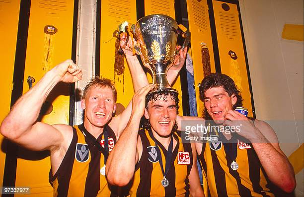 Greg Dean and Gary Ayres of the Hawks celebrate with the trophy following the AFL Grand Final match between Hawthorn Hawks and Geelong Cats at the...
