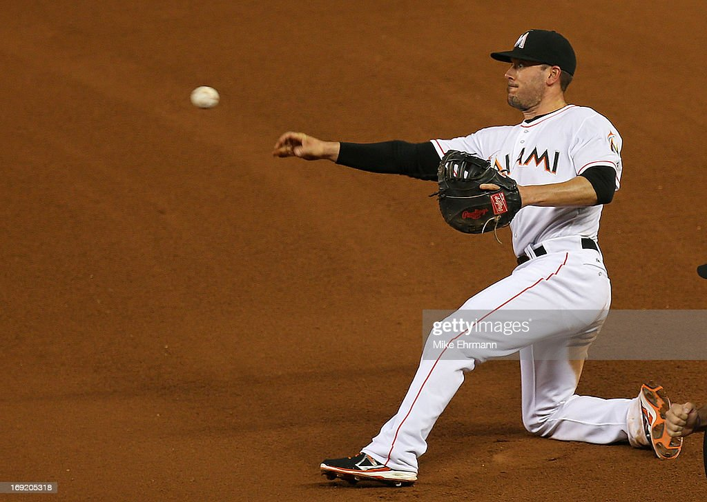Greg Dobbs #29 of the Miami Marlins makes a toss to first during a game against the Philadelphia Phillies at Marlins Park on May 21, 2013 in Miami, Florida.