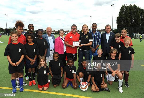 Greg Dyke Faye White Mark Bright and Roy Hodgson pose for photos with childen during The FA's Sir Bobby Robson National Football Day at Kings College...