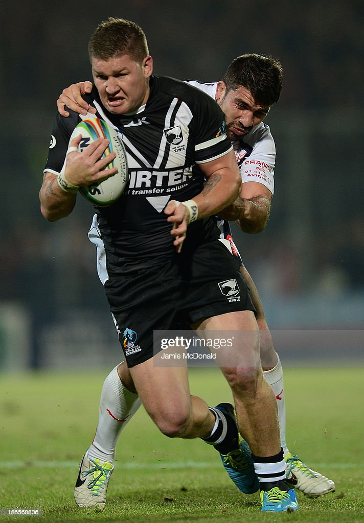 Greg Eastwood of New Zealand is tackled by Mickael Simon of France during the Rugby League World Cup group B match between New Zealand and France at Parc des Sports on November 1, 2013 in Avignon, France.