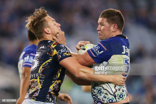 Greg Eastwood of the Bulldogs is tackled by Coen Hess of the Cowboys during the round 10 NRL match between the Canterbury Bulldogs and the North...