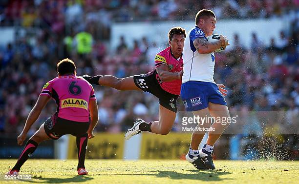 Greg Eastwood of the Bulldogs is tackled by Elijah Taylor of the Panthers during the NRL Trial match between the Canterbury Bulldogs and the Penrith...