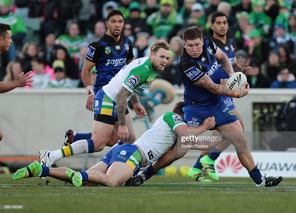 Greg Eastwood of the Bulldogs is tackled during the round 12 NRL match between the Canberra Raiders and the Canterbury Bulldogs at GIO Stadium on May 29, 2016 in Canberra, Australia.