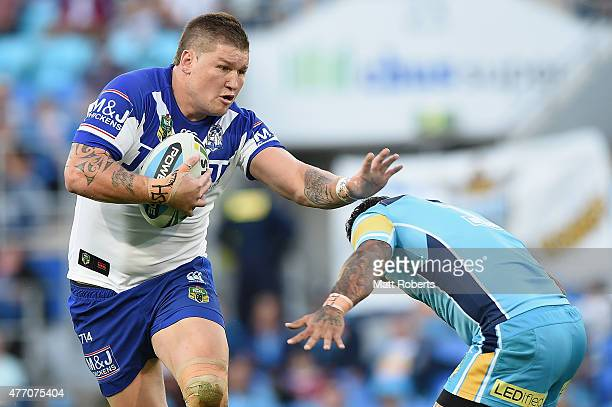 Greg Eastwood of the Bulldogs is tackled during the round 14 NRL match between the Gold Coast Titans and the Canterbury Bulldogs at Cbus Super...