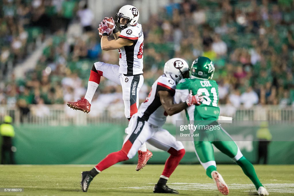 Greg Ellingson #82 of the Ottawa Redblacks goes up to make a catch in the game between the Ottawa Redblacks and the Saskatchewan Roughriders at Mosaic Stadium on July 22, 2016 in Regina, Canada.