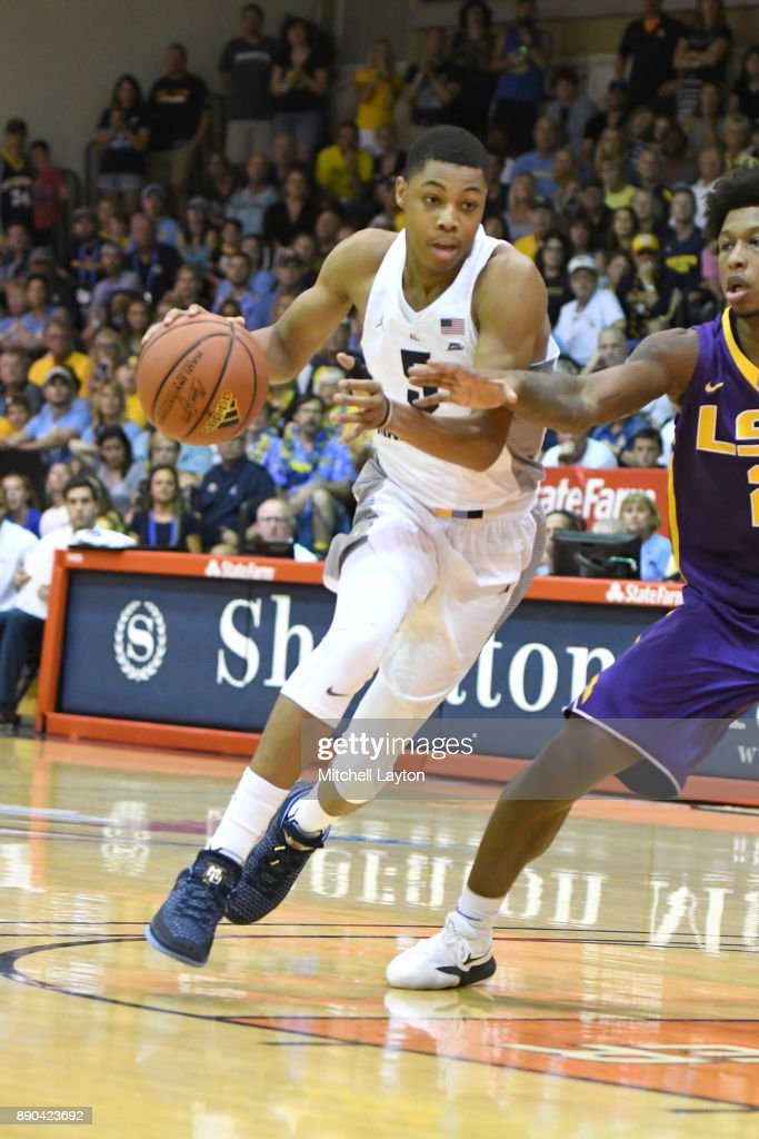 Greg Elliott #5 of the Marquette Golden Eagles dribbles the ball during a consultation college basketball game at the Maui Invitational against the LSU Tigers at the Lahaina Civic Center on November 22, 2017 in Lahaina, Hawaii. The Golden Eagles won 94-84.