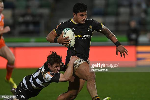 Greg Foe of Wellington is tackled by Brad Weber of Hawke's Bay during the round one Mitre 10 Cup match between Hawkes Bay and Wellington on August 20...