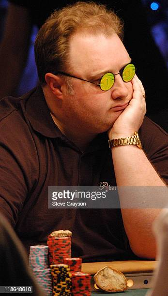 Greg 'Fossilman' Raymer peers through his green tinted sunglasses during day six of the 2004 World Series of Poker at Binion's Horseshoe Club and...