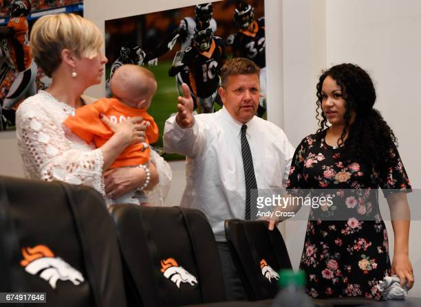 Greg Freeman third from left helps Natalie Bolles right to her seat while his wife Emily holds Natalie's son Kingston 4monthsold before Denver...