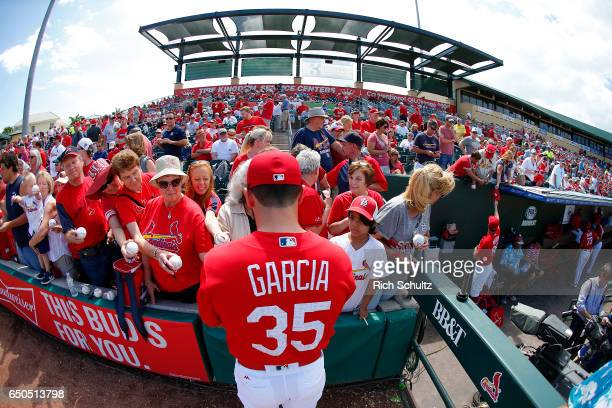 Greg Garcia of the St Louis Cardinal signs autographes before a spring training game against the Houston Astros at Roger Dean Stadium on March 9 2017...