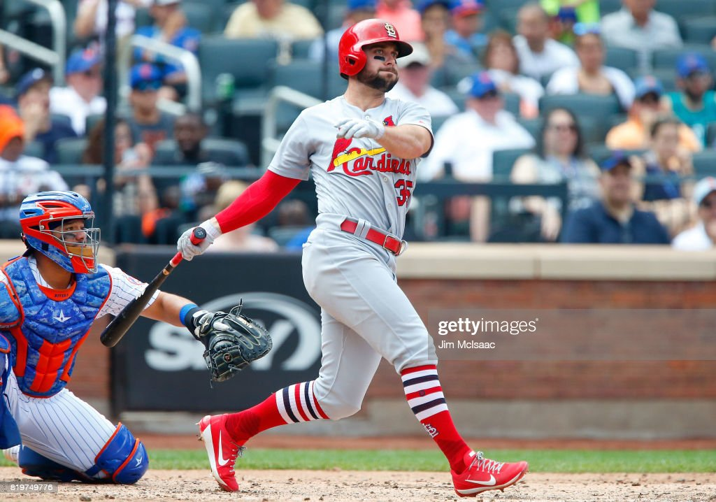 Greg Garcia #35 of the St. Louis Cardinals follows through on a fifth inning double against the New York Mets on July 20, 2017 at Citi Field in the Flushing neighborhood of the Queens borough of New York City.