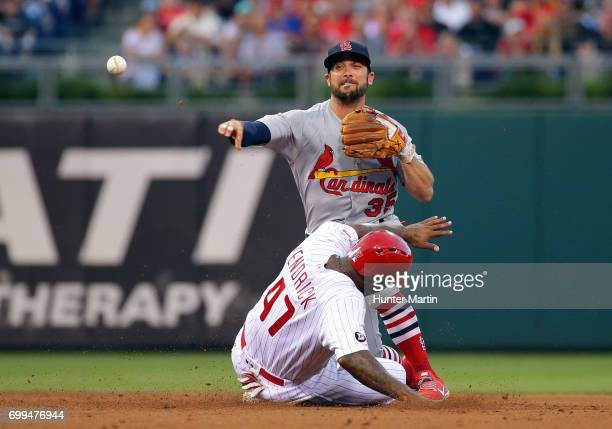 Greg Garcia of the St Louis Cardinals forces out Howie Kendrick of the Philadelphia Phillies at second base in the fourth inning during a game at...