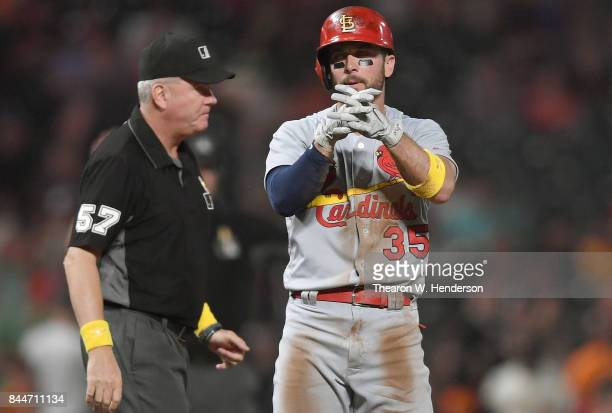 Greg Garcia of the St Louis Cardinals stands on third base and celebrates after hitting an rbi triple scoring Stephen Piscotty against the San...