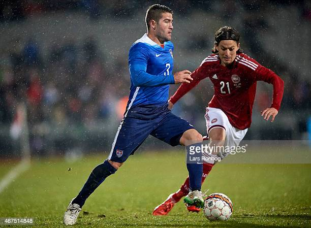 Greg Garza of United States and Lasse Vibe of Denmark compete for the ball during the International Friendly match between Denmark and Unites States...
