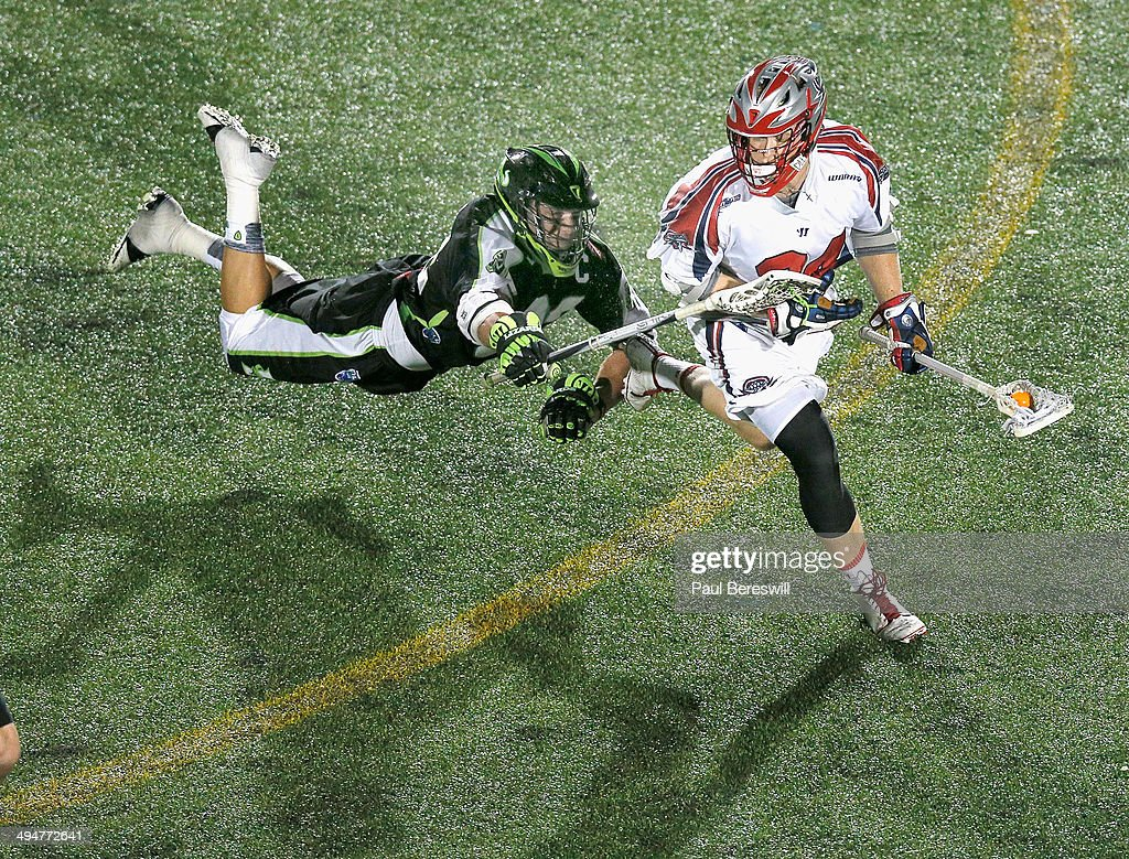 Greg Gurenlian #32 of the New York Lizards dives after Chris Eck #24 of the Boston Cannons during the second half of a Major League Lacrosse game against the Boston Cannons at James M. Shuart Stadium on May 30, 2014 in Hempstead, New York.