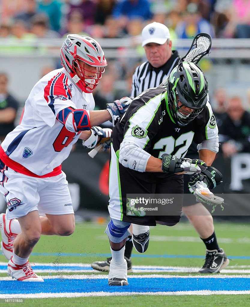 Greg Gurenlian #32 of the New York Lizzards is chased by Chris Mattes #65 of the Boston Cannons in the first half of a Major League Lacrosse game at James M. Shuart Stadium on April 28, 2013 in Hempstead, New York.