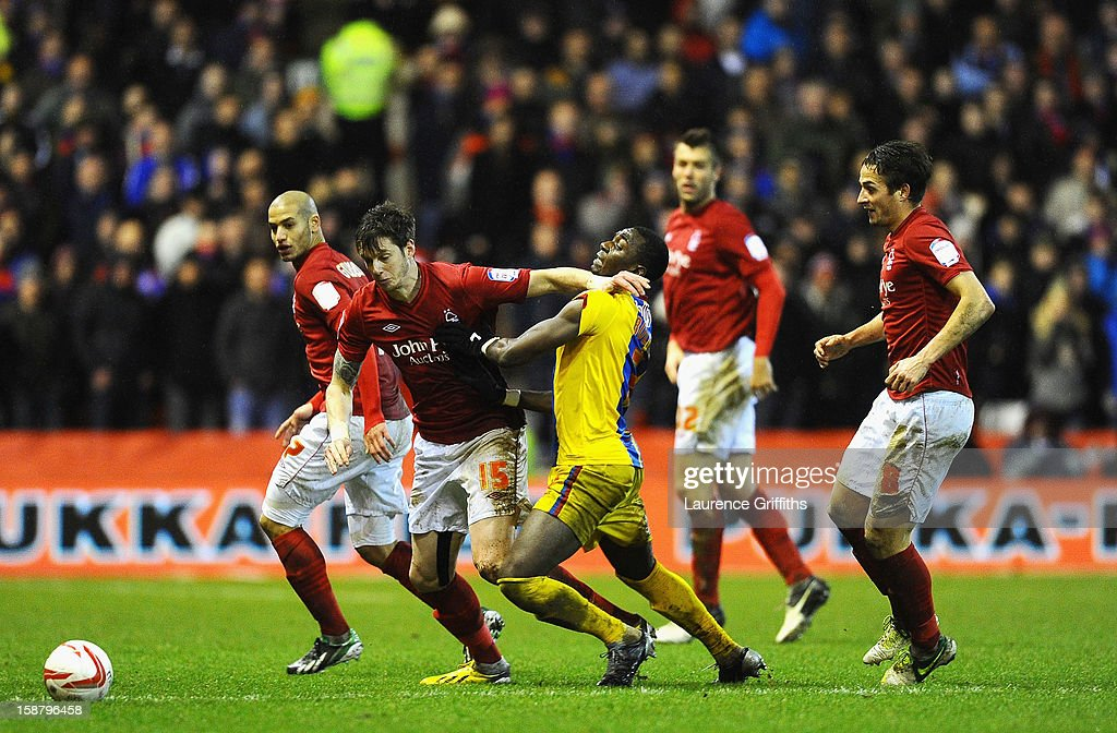 Greg Halford of Nottingham Forest battles with Yannick Bolasie of Crystal Palace during the npower Championship match between Nottingham Forest and Crystal Palace at City Ground on December 29, 2012 in Nottingham, England.