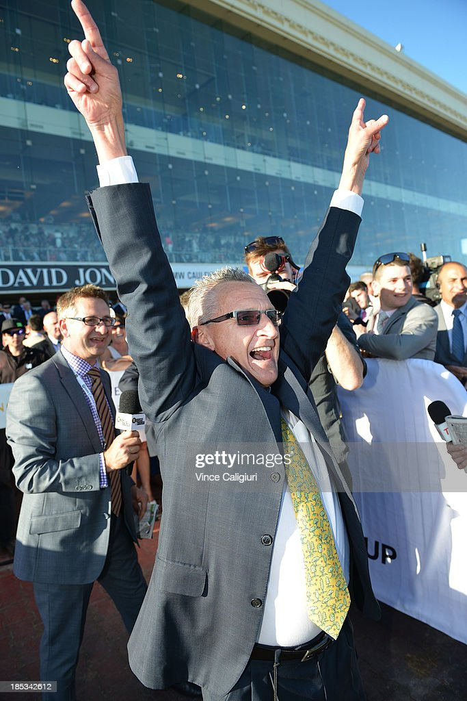 Greg Hall reacts after his son Nicholas Hall rode Fawkner to win the BMW Caulfield Cup during Caulfield Cup day at Caulfield Racecourse on October 19, 2013 in Melbourne, Australia.