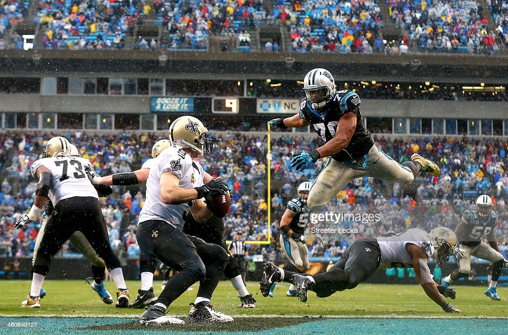 <a gi-track='captionPersonalityLinkClicked' href=/galleries/search?phrase=Greg+Hardy+-+American+Football+Player&family=editorial&specificpeople=11356683 ng-click='$event.stopPropagation()'>Greg Hardy</a> #76 of the Carolina Panthers goes after <a gi-track='captionPersonalityLinkClicked' href=/galleries/search?phrase=Drew+Brees&family=editorial&specificpeople=202562 ng-click='$event.stopPropagation()'>Drew Brees</a> #9 of the New Orleans Saints during their game at Bank against the Carolina Panthers of America Stadium on December 22, 2013 in Charlotte, North Carolina.