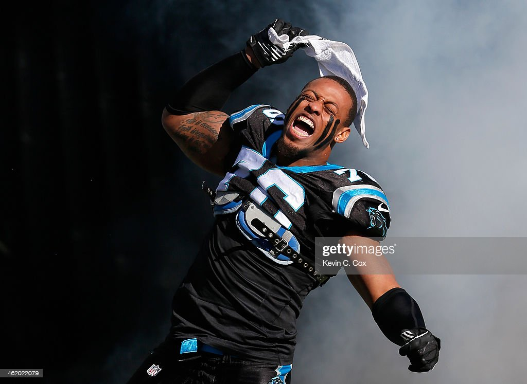 <a gi-track='captionPersonalityLinkClicked' href=/galleries/search?phrase=Greg+Hardy+-+American+Football+Player&family=editorial&specificpeople=11356683 ng-click='$event.stopPropagation()'>Greg Hardy</a> #76 of the Carolina Panthers runs onto the field during player introductions against the San Francisco 49ers during the NFC Divisional Playoff Game at Bank of America Stadium on January 12, 2014 in Charlotte, North Carolina.