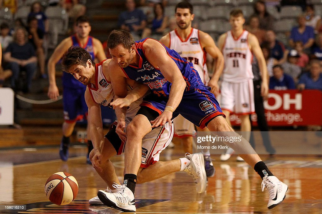 Greg Hire of Perth and Anthony Petrie of Adelaide competes for the ball during the round ten NBL match between the Adelaide 36ers and the Perth Wildcats at Adelaide Arena on December 9, 2012 in Adelaide, Australia.