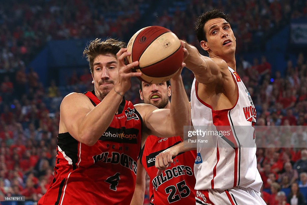 Greg Hire of the Wildcats and Oscar Forman of the Hawks contest a loose ball during game one of the NBL Semi Final Series between the Perth Wildcats and the Wollongong Hawks at Perth Arena on March 28, 2013 in Perth, Australia.